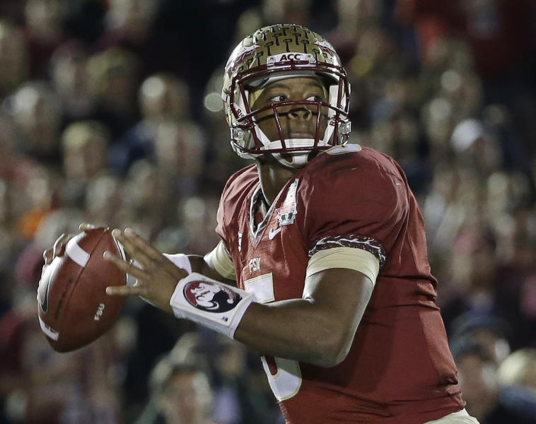 Florida State's Jameis Winston (5) throws during the first half of the NCAA BCS National Championship college football game against Auburn Monday, Jan. 6, 2014, in Pasadena, Calif.(AP Photo/David J. Phillip)
