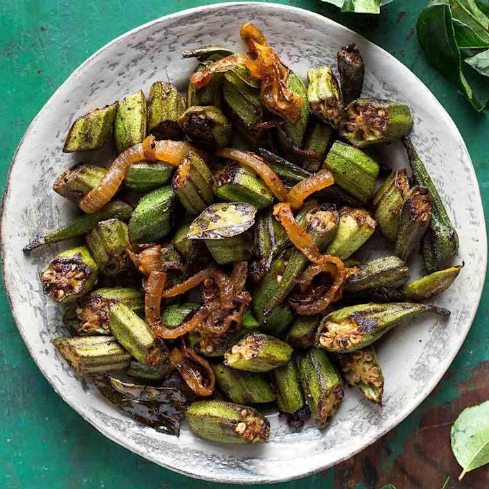 <p>To avoid the sliminess that turns many people off okra, Indians cook it over high heat in a lot of oil. In this healthy okra recipe, we get similar results with less oil using a nonstick pan. For an authentic taste, use a hot, smoky Indian chili powder, such as reshampatti. Serve with brown basmati rice and yogurt.</p>