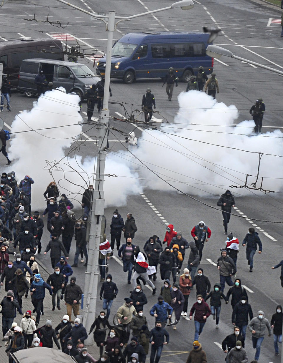 Belarusian riot police use flash grenades against demonstrators during an opposition rally to protest the official presidential election results in Minsk, Belarus, Sunday, Nov. 15, 2020. The Sunday demonstrations continued to wave of near-daily protests that have gripped Belarus since early August. In the capital Minsk, police wielded clubs and used tear gas and water cannon disperse thousands of demonstrators. (AP Photo)