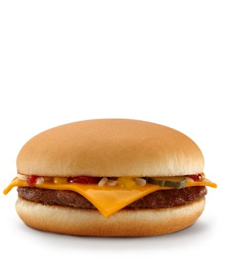 Photo by: McDonalds<br />McDonald's Cheeseburger-<br />Calories: 300 Fat: 12 grams <br> <br> There's no sugar-coating what this is: a greasy beef patty oozing with processed cheese, factory cut onions and pickles between a defrosted bun. A splurge is a splurge but it's smaller in size to Starbucks turkey sandwich. It's also got 90 fewer calories. It's even lower in carbs and at 750 mg of sodium you still have another 750 to play with for dinner.