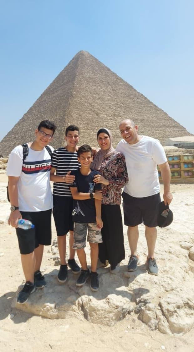 Abdallah Alhamadni (right) is pictured with his wife and children after being reunited in Egypt. (Submitted by Matthew Behrens - image credit)