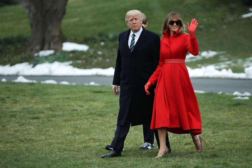 <p>Melania sported a custom-made red coat designed by Alice Roi with gloves and leather belt to match. She accessorized with her favorite Gucci sunglasses.</p>