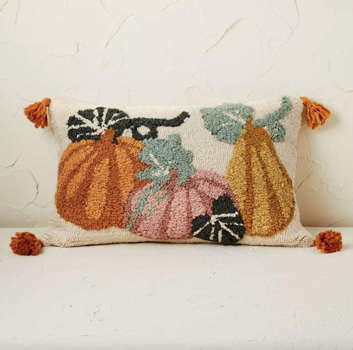 <p>Whether you're looking to update your bedroom or your living room, this <span>Pumpkin Lumbar Throw Pillow</span> ($25) is an easy way to give a space an instant fall update. How cute are those tassels?</p>