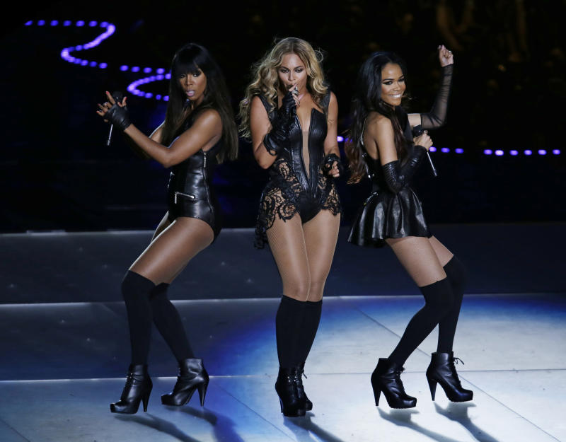 Beyonce performs with Kelly Rowland, left, and Michelle Williams, right, of Destiny's Child, during the halftime show of the NFL Super Bowl XLVII football game between the San Francisco 49ers and the Baltimore Ravens, Sunday, Feb. 3, 2013, in New Orleans. (AP Photo/Gerald Herbert)