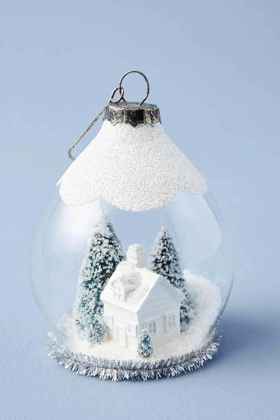 """<p>Showcase a snowy Winter day with the <a href=""""https://www.popsugar.com/buy/Snow-Globe-Blizzard-Ornament-490534?p_name=Snow%20Globe%20Blizzard%20Ornament&retailer=anthropologie.com&pid=490534&price=24&evar1=casa%3Aus&evar9=46615300&evar98=https%3A%2F%2Fwww.popsugar.com%2Fhome%2Fphoto-gallery%2F46615300%2Fimage%2F46615405%2FSnow-Globe-Blizzard-Ornament&list1=shopping%2Canthropologie%2Choliday%2Cchristmas%2Cchristmas%20decorations%2Choliday%20decor%2Chome%20shopping&prop13=mobile&pdata=1"""" rel=""""nofollow noopener"""" class=""""link rapid-noclick-resp"""" target=""""_blank"""" data-ylk=""""slk:Snow Globe Blizzard Ornament"""">Snow Globe Blizzard Ornament</a> ($24).</p>"""