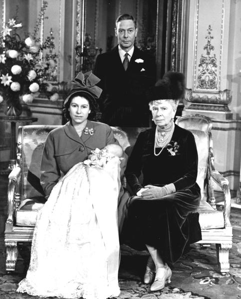 FILE - In this Dec. 15, 1948 file photo, Britain's Princess Elizabeth, later Queen Elizabeth II, holds her son Prince Charles at Buckingham Palace, following his christening. Seated at right is her grandmother Queen Mary, the mother of her father, King George VI, background. Prince Charles is readying the paperwork to claim his pension when he turns 65 on Thursday, Nov. 14, 2013, but he still hasn't started the job he was born to do. (AP Photo, Pool, File)