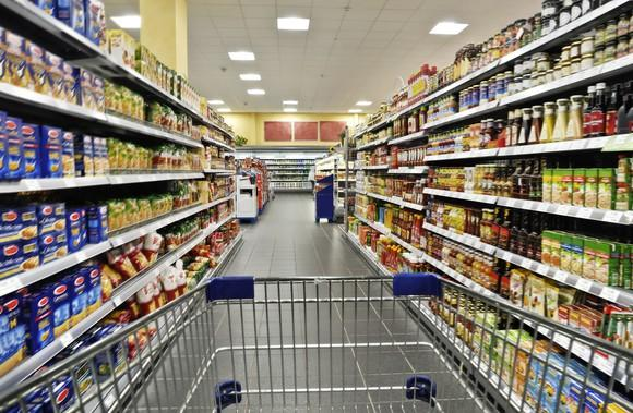 A Grocery Store Aisle As Viewed From Inside A Grocery Cart.