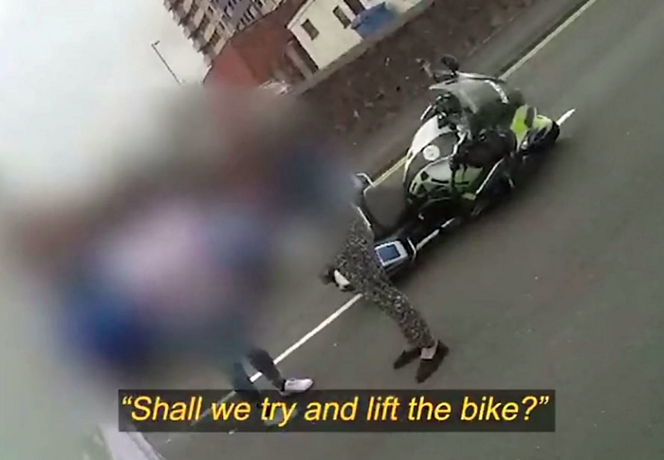 Passers-by offered to move the bike off the road. (SWNS)