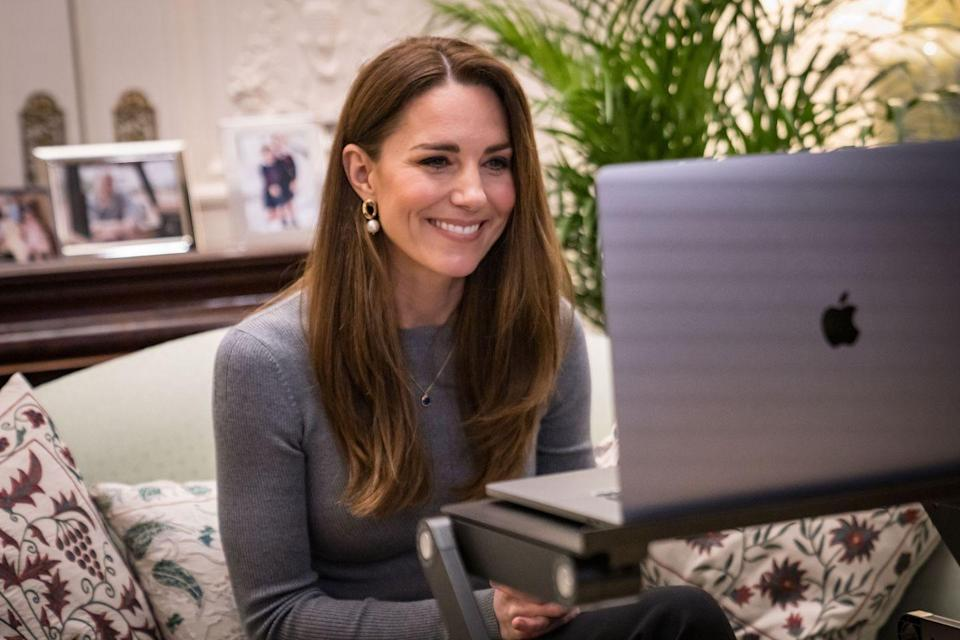 """<p>Kate opted for an Alexander McQueen sweater, Simone Rocha earrings, and a simple necklace during <a href=""""https://www.townandcountrymag.com/society/tradition/a35335022/kate-middleton-holocaust-memorial-day-call-video-2021/"""" rel=""""nofollow noopener"""" target=""""_blank"""" data-ylk=""""slk:a video call to mark Holocaust Memorial Day"""" class=""""link rapid-noclick-resp"""">a video call to mark Holocaust Memorial Day</a>. </p>"""
