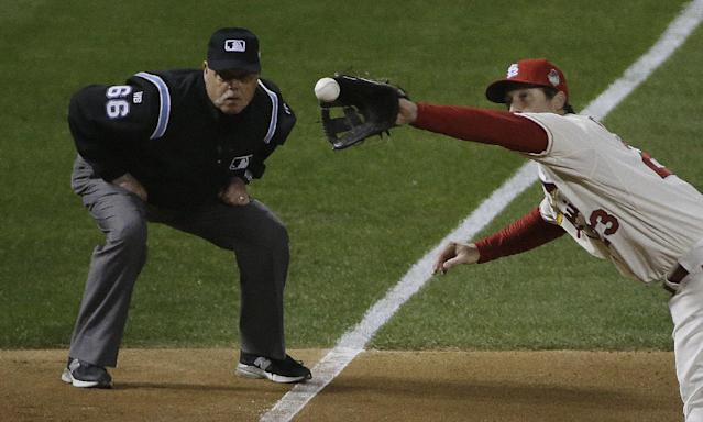 Umpire Jim Joyce watches as St. Louis Cardinals third baseman David Freese catches a line drive hit by Boston Red Sox's Dustin Pedroia during the sixth inning of Game 3 of baseball's World Series Saturday, Oct. 26, 2013, in St. Louis. (AP Photo/David J. Phillip)