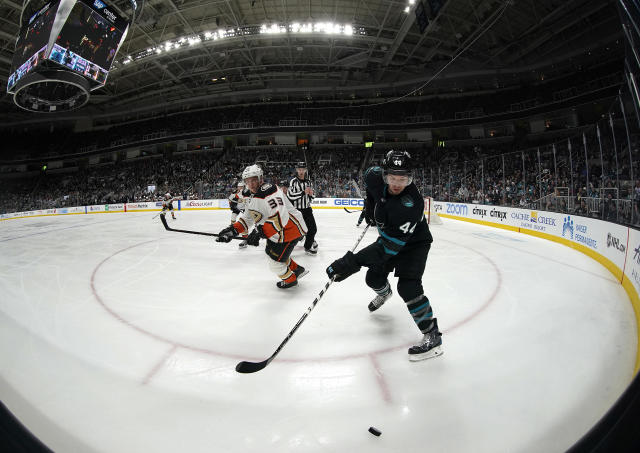 San Jose Sharks defenseman Marc-Edouard Vlasic (44) chases down the puck against Anaheim Ducks right wing Jakob Silfverberg (33) during the second period of an NHL hockey game in San Jose, Calif., Thursday, Dec. 27, 2018. (AP Photo/Tony Avelar)