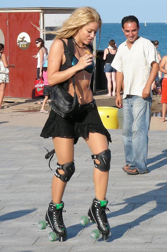 """The taut, toned star also tried out her moves on some old-school roller skates for the """"Loca"""" video clip -- the song is a duet with British rapper Dizzee Rascal for Shaki's upcoming Spanish album <i>Sale el Sol</i>. OHPIX/<a href=""""http://www.x17online.com"""" target=""""new"""">X17 Online</a> - August 17, 2010"""