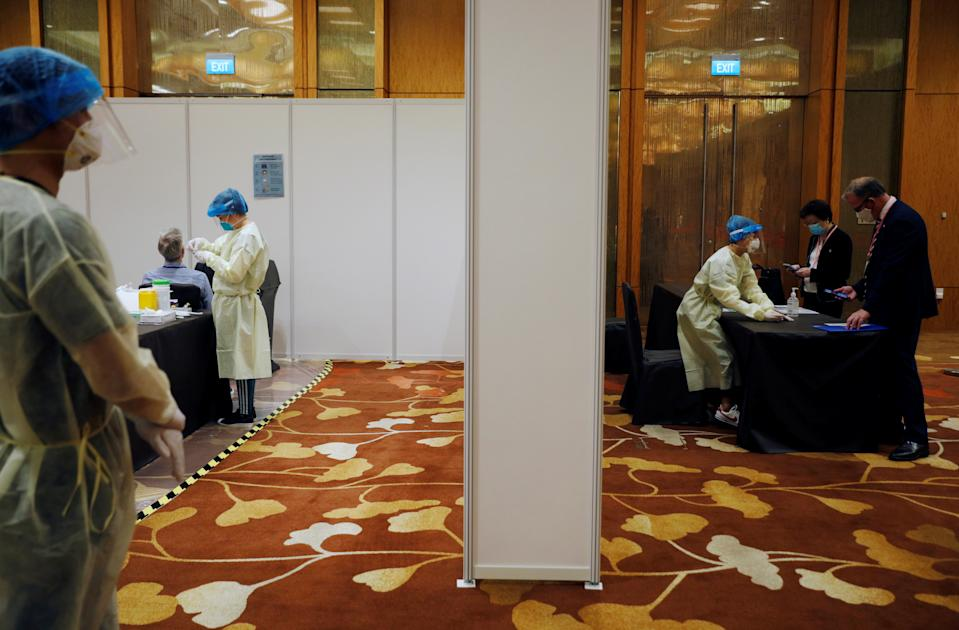 Attendees arrive to take a COVID-19 antigen rapid test before a conference held at Marina Bay Sands Convention Centre in Singapore.