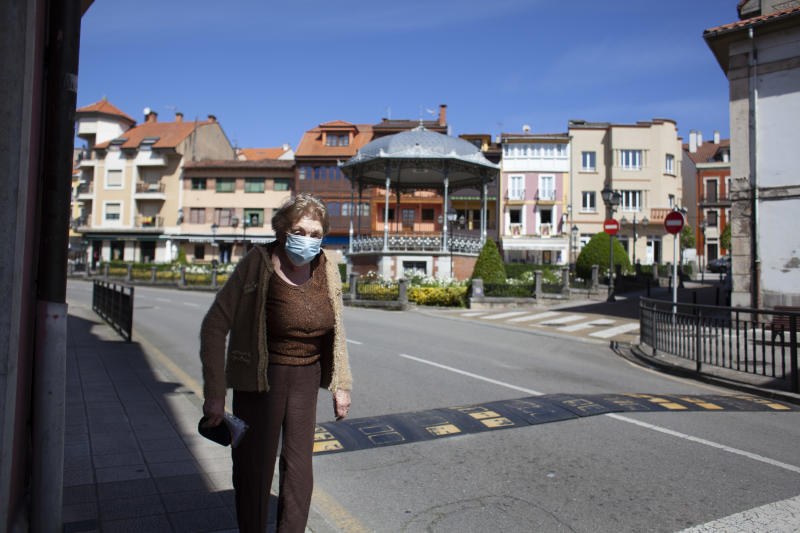 An older woman walks down a street in Norena, Spain, on May 6, 2020 at the time established by the Spanish government for the elderly. On the third day of Phase 0 decreed by the Spanish Government. Spanish citizens can leave the house to walk and exercise outdoors, but only in certain time zones and divided by age. They can also take advantage to go to the hairdresser and continue their purchases in the small shop. (Photo by Alvaro Fuente/NurPhoto via Getty Images)