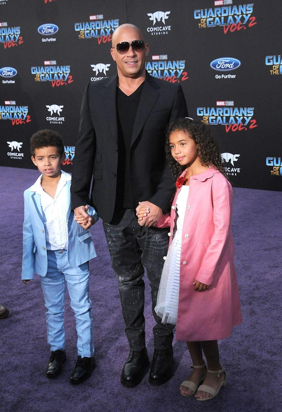 """<p>You might be surprised to find out that Vin Disel has not one, not two, but three kids with his partner Paloma Jiménez. Their names are Hania, Vincent, and Pauline—and the youngest, Pauline, was named for his <em>Fast and Furious</em> <a href=""""https://www.eonline.com/de/news/638442/vin-diesel-names-his-daughter-pauline-in-honor-of-his-late-fast-and-furious-co-star-paul-walker-get-the-details"""" rel=""""nofollow noopener"""" target=""""_blank"""" data-ylk=""""slk:co-star Paul Walker"""" class=""""link rapid-noclick-resp"""">co-star Paul Walker</a>. </p>"""