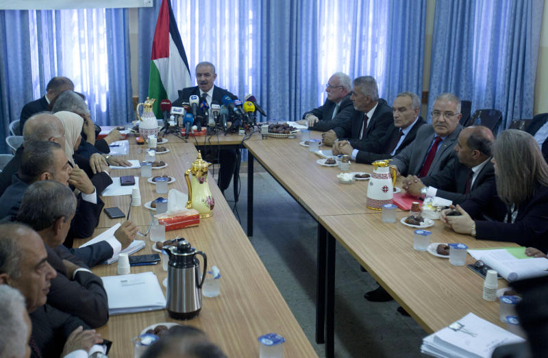 "Palestinian Prime Minister Mohammed Shtayyeh, center, chairs a cabinet meeting in the Jordan Valley village of Fasayil, Monday, Sept. 16, 2019. Israeli Prime Minister Benjmin Netanyahu has vowed to annex ""all the settlements"" in the West Bank in a bid to whip up support as Israelis head to the polls Tuesday in the second election this year. To protest that announcement, the Palestinian Authority held a Cabinet meeting in the Jordan Valley on Monday, a day after Israel's Cabinet met elsewhere in the valley. (AP Photo/Majdi Mohammed)"