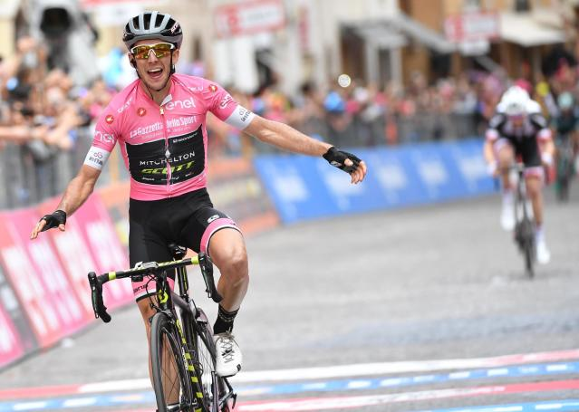 Britain's Simon Yates crosses the finish line to win the 11th stage of the Giro dItalia cycling race from Assisi to Osimo, Italy, Wednesday, May 16, 2018. (Daniel Dal Zennaro/ANSA via AP)