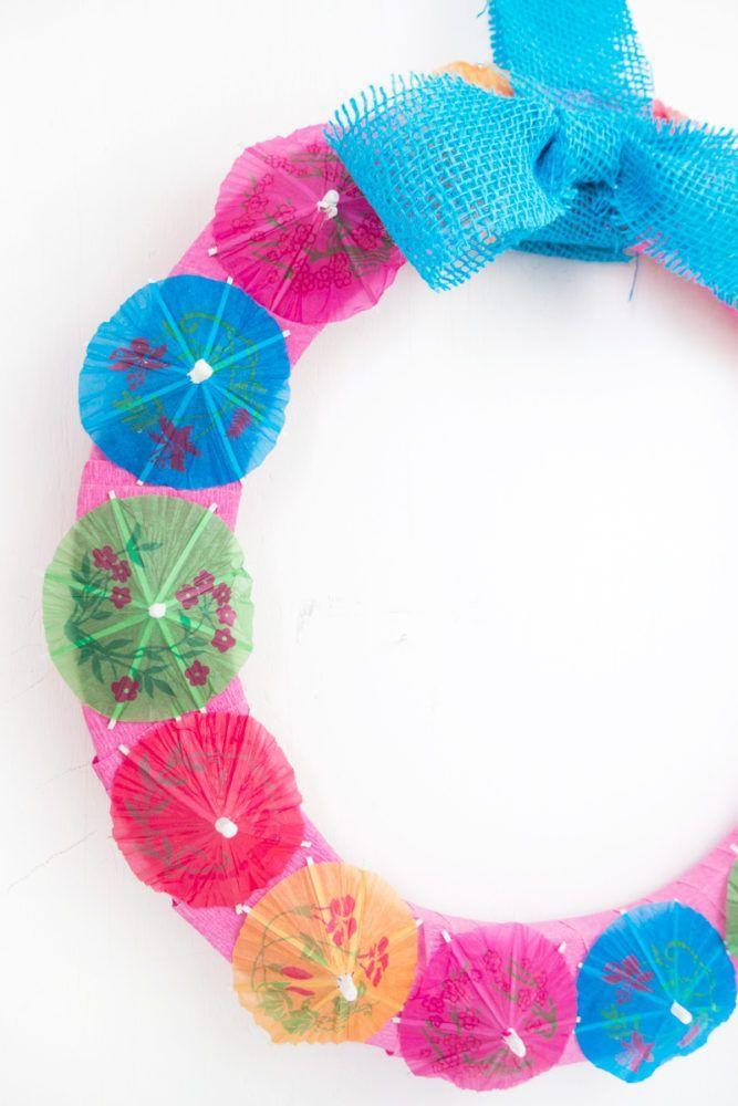 "<p>Totally adorbs and absolutely easy to make, this wreath will have you longing for a frozen cocktail as you lay poolside.</p><p><strong>Get the tutorial at <a href=""http://blog.consumercrafts.com/seasonal/summer-projects-seasonal/cocktail-umbrella-craft/"" rel=""nofollow noopener"" target=""_blank"" data-ylk=""slk:Crafts Unleashed"" class=""link rapid-noclick-resp"">Crafts Unleashed</a>.</strong></p><p><a class=""link rapid-noclick-resp"" href=""https://www.amazon.com/KingSeal-Umbrella-Parasol-Cocktail-Cupcake/dp/B013KPL6LS/ref=sr_1_1_sspa?tag=syn-yahoo-20&ascsubtag=%5Bartid%7C10050.g.4395%5Bsrc%7Cyahoo-us"" rel=""nofollow noopener"" target=""_blank"" data-ylk=""slk:SHOP COCKTAIL UMBRELLAS"">SHOP COCKTAIL UMBRELLAS</a><br></p>"