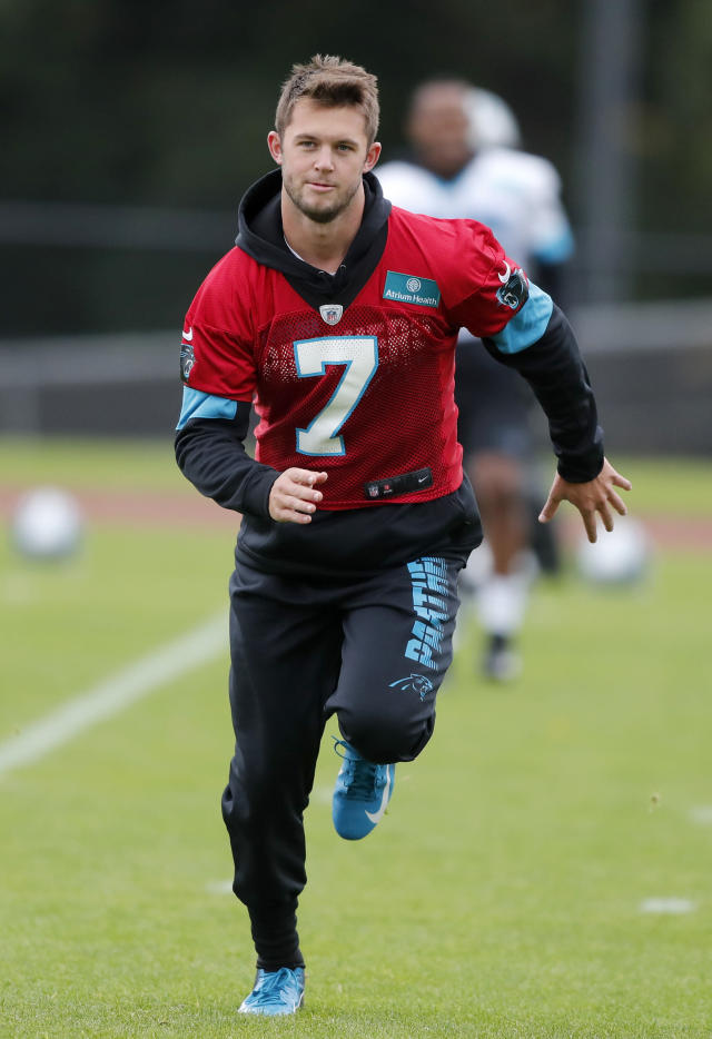 Panthers QB Kyle Allen warms up during a NFL training session of the Carolina Panthers at Harrow School in London, Friday, Oct. 11, 2019. The Carolina Panthers are preparing for an NFL regular season game against the Tampa Bay Buccaneers in London on Sunday. (AP Photo/Frank Augstein)