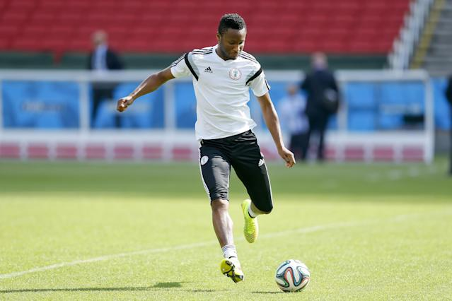 Nigeria's John Obi Mikel kicks the ball during a training session at Beira-Rio Stadium in Porto Alegre, Brazil, Tuesday, June 24, 2014. Nigeria plays in group F of the 2014 soccer World Cup. (AP Photo/Victor R. Caivano)