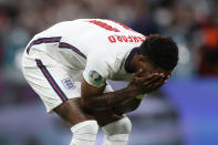 England's Marcus Rashford reacts after failing to score a penalty during a shootout at the end of the Euro 2020 soccer championship final match between England and Italy at Wembley stadium in London, Sunday, July 11, 2021. Italy defeated England 3-2 in a penalty shootout after the game ended in a 1-1 draw. (Carl Recine/Pool Photo via AP)