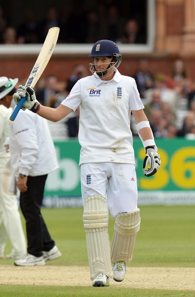 England's Joe Root celebrates scoring 50 not out during the first test at Lord's Cricket Ground, London.