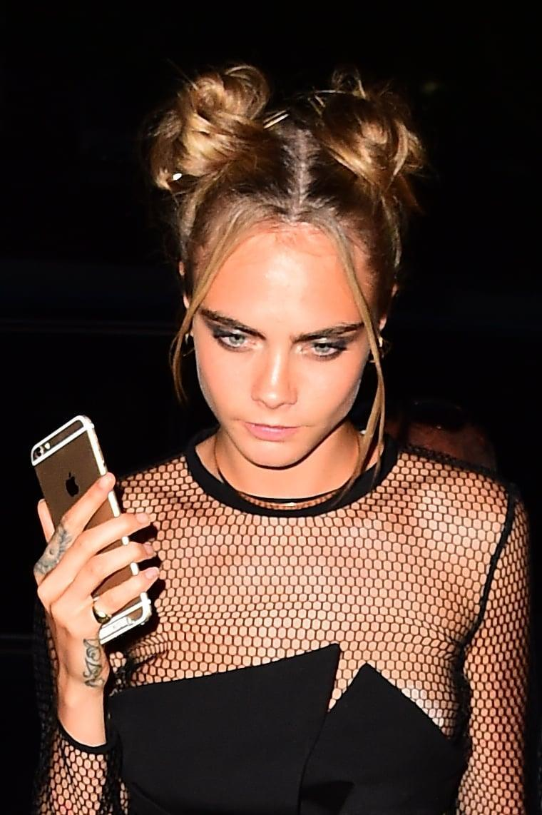 <p>Delevingne gave us all the '90s vibes with high, slightly messy space buns and two face-framing tendrils of hair purposefully left hanging loose. </p>