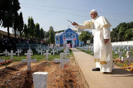 Pope Francis walks through the cemetery at the Church of the Holy Rosary in Dhaka, Bangladesh, December 2, 2017. REUTERS/Max Rossi
