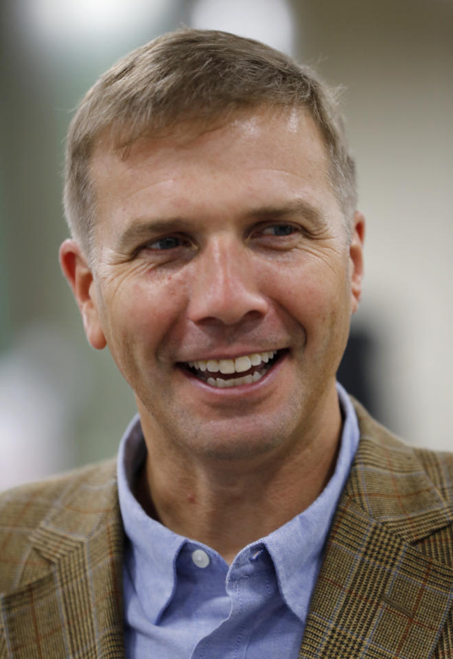 """Steve Smith, president and CEO of L.L. Bean, attends a ceremony at the company's new plant in Lewiston, Maine, Thursday, Aug. 17, 2017. The Maine-based retailer plans to expand production to keep up with demand for its leather-and-rubber """"duck boot"""" with a new manufacturing center being unveiled Thursday. The company hopes to make 750,000 pairs of boots this year, and to hit the 1 million mark in 2018. (AP Photo/Robert F. Bukaty)"""