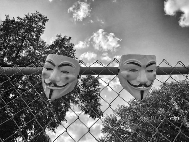 "<p>A pair of Guy Fawkes masks hang on a fence inside Boston Common, after a counterprotest against a ""free speech"" rally staged by conservative activists Aug. 19 in Boston (Photo: Holly Bailey/Yahoo News) </p>"