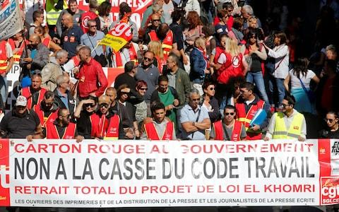 Demonstrators, holding CGT labour union flags, attend a national strike and protest against the government's labour reforms in Marseille - Credit: JEAN-PAUL PELISSIER/Reuters