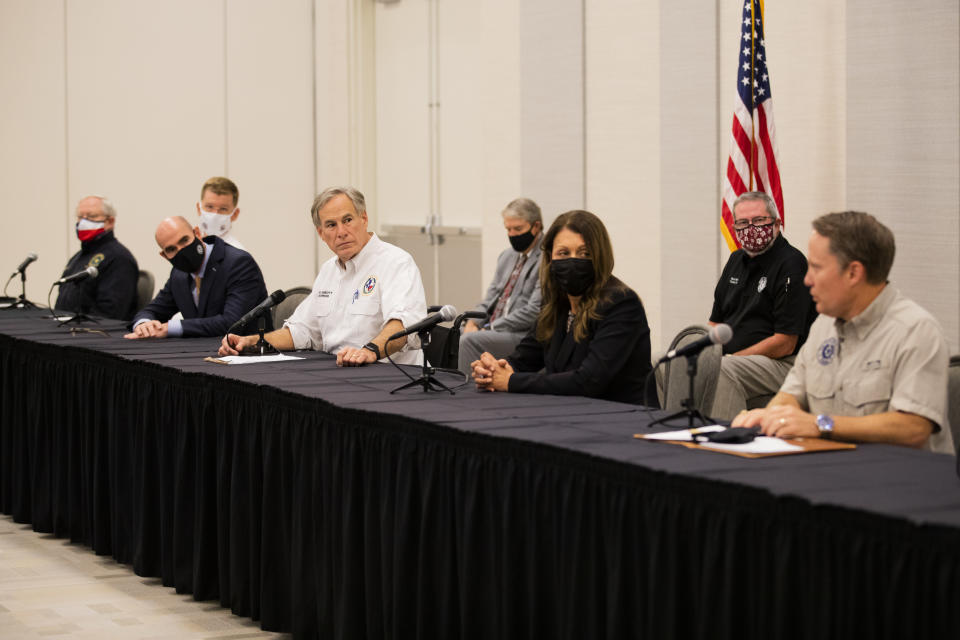 Texas Governor Greg Abbott and other state officials listen to Texas Commission on Environmental Quality executive director Toby Baker talk about steps to be taken so water is safe again for the community of Lake Jackson, Texas on Tuesday, Sept. 29, 2020. A Houston-area official says it will take 60 days to ensure a city drinking water system is purged of a deadly, microscopic parasite that led to warnings over the weekend not to drink tap water. Lake Jackson City Manager Modesto Mundo said Monday that three of 11 samples of the city's water indicated preliminary positive results for the naegleria fowleri microbe. (Marie D. De Jesús/Houston Chronicle via AP)
