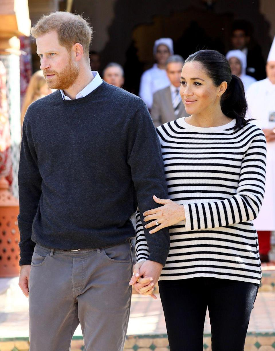 <p>The Duke and Duchess of Sussex attended a cooking demonstration in Morocco, where children from underprivileged backgrounds learned to cook from one of Morocco's foremost chefs. Meghan, then pregnant, wore a navy and white striped sweater, while Harry chose a collared shirt and sweater. </p>