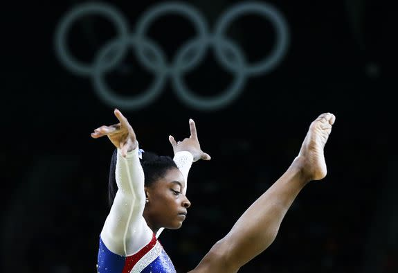 epa05474969 Simone Biles of the USA performs on the Beam in the women's Individual All-Around final of the Rio 2016 Olympic Games Artistic Gymnastics events at the Rio Olympic Arena in Barra da Tijuca, Rio de Janeiro, Brazil, 11 August 2016. EPA/TATYANA ZENKOVICH
