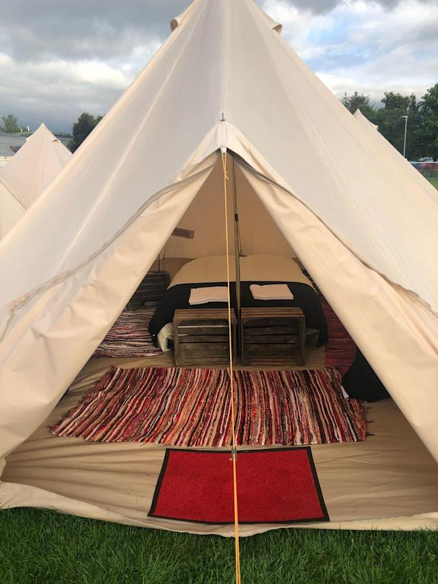 """<div class=""""caption""""> For those who preferred a bed to a sleeping bag, 'Glamping' had you covered. </div> <cite class=""""credit"""">Brian Wacker</cite>"""