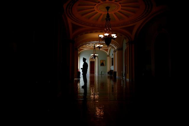A Capitol police officer is seen in the Ohio Clock corridor on Capitol Hill in Washington, U.S. March 22, 2018. REUTERS/Eric Thayer TPX IMAGES OF THE DAY