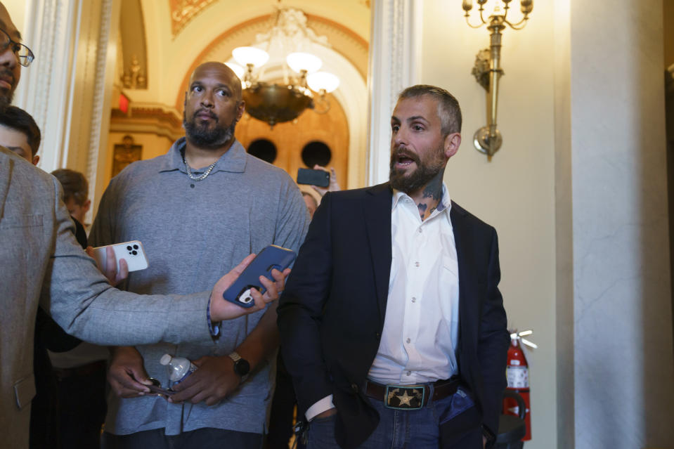 Michael Fanone, a Washington Metropolitan Police Department officer who was attacked and beaten during the Jan. 6, attack on the Capitol, and Harry Dunn, left, a U.S. Capitol Police officer who also faced the rioters, talks to reporters as they leave a meeting with House Minority Leader Kevin McCarthy, R-Calif., at the Capitol in Washington, Friday, June 25, 2021. House Speaker Nancy Pelosi announced Thursday she's creating a special committee to investigate the attack by a mob of Trump supporters who sought to interrupt the certification of Joe Biden's presidential election victory. (AP Photo/J. Scott Applewhite)