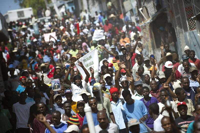 Demonstrators march against the government of Haitian President Michel Martelly and to demand lower fuel prices, in Port-au-Prince, on March 5, 2015