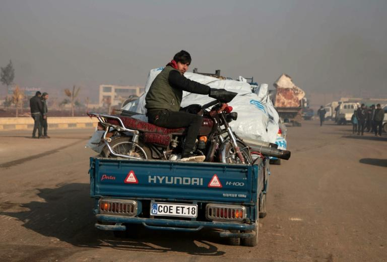 Syrians carrying their belongings have been fleeing the southern Idlib region toward the north amid heavy bombardment