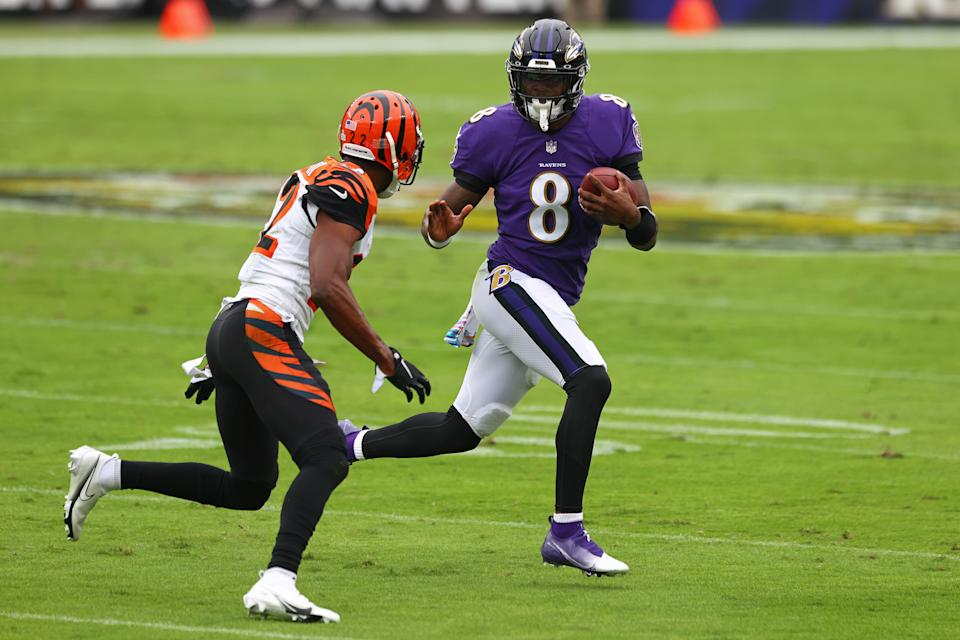 BALTIMORE, MARYLAND - OCTOBER 11: Lamar Jackson #8 of the Baltimore Ravens runs with the ball during the first half against the Cincinnati Bengals at M&T Bank Stadium on October 11, 2020 in Baltimore, Maryland. (Photo by Todd Olszewski/Getty Images)