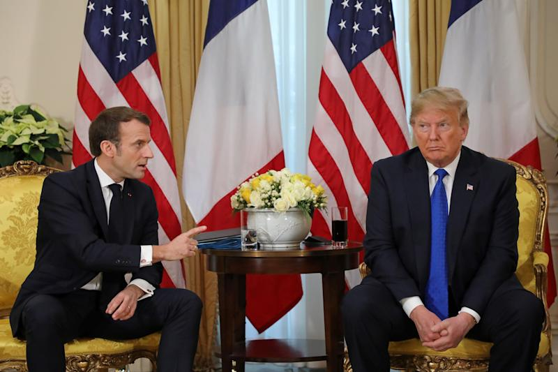 President Trump listens to French President Emmanuel Macron during their meeting at Winfield House in London on Tuesday. (Photo by Ludovic Marin/AFP via Getty Images)
