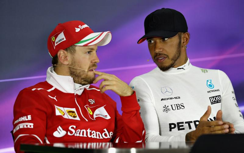 Sebastian Vettel and Lewis Hamilton  - Credit: getty images
