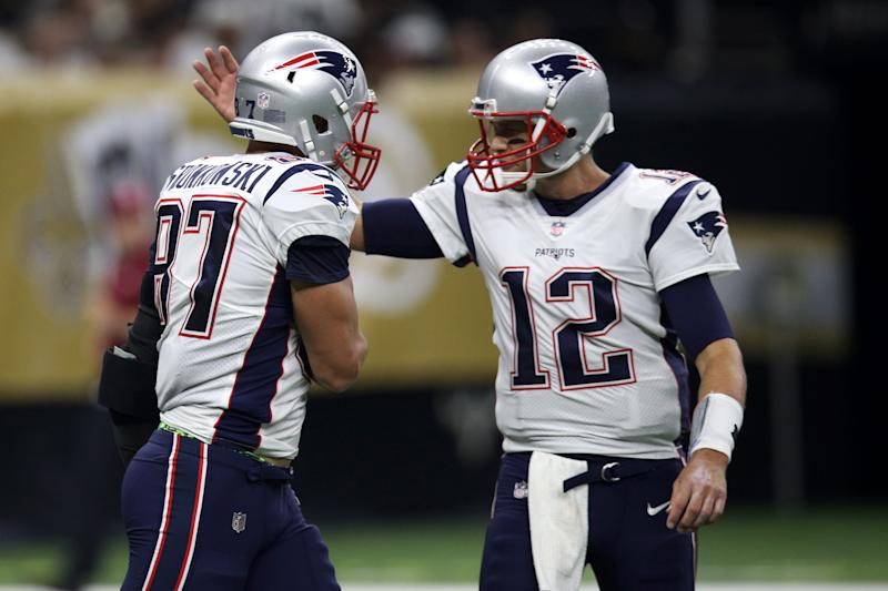 NEW ORLEANS, LA - SEPTEMBER 17: Tom Brady #12 and Rob Gronkowski #87 of the New England Patriots celebrate after a touchdown against the New Orleans Saints at the Mercedes-Benz Superdome on September 17, 2017 in New Orleans, Louisiana. (Photo by Chris Graythen/Getty Images)