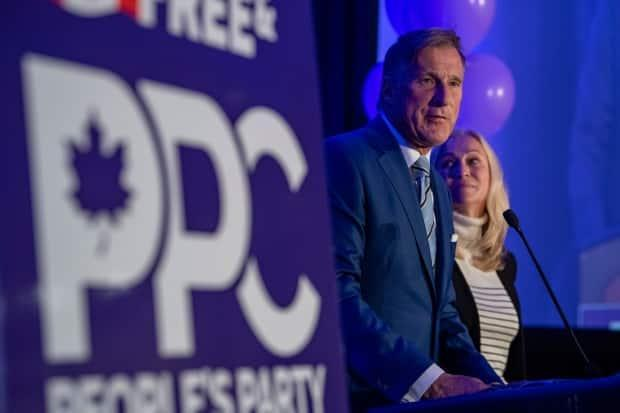 People's Party of Canada Leader Maxime Bernier, with his wife, Catherine Letarte, speaks from a podium to supporters during the PPC headquarters election night event in Saskatoon on Sept. 20, 2021.  (Liam Richards/The Canadian Press - image credit)