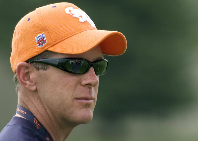 FILE - In this Aug. 6, 2007, file photo, Denver Broncos general manager Ted Sundquist looks on during NFL football training camp in Englewood, Colo. The former Broncos general manager says that the NFL's vetting process wasn't particularly thorough for many of his years in the NFL, but he's certain it is more efficient now. (AP Photo/Steve Dykes, File)