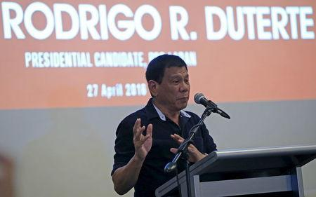 Philippine presidential candidate and Davao ciity mayor Rodrigo 'Digong' Duterte gestures during the 2016 presidential dialogue with members of Makati business club in a hotel in Makati city, metro Manila, April 27, 2016. REUTERS/Romeo Ranoco