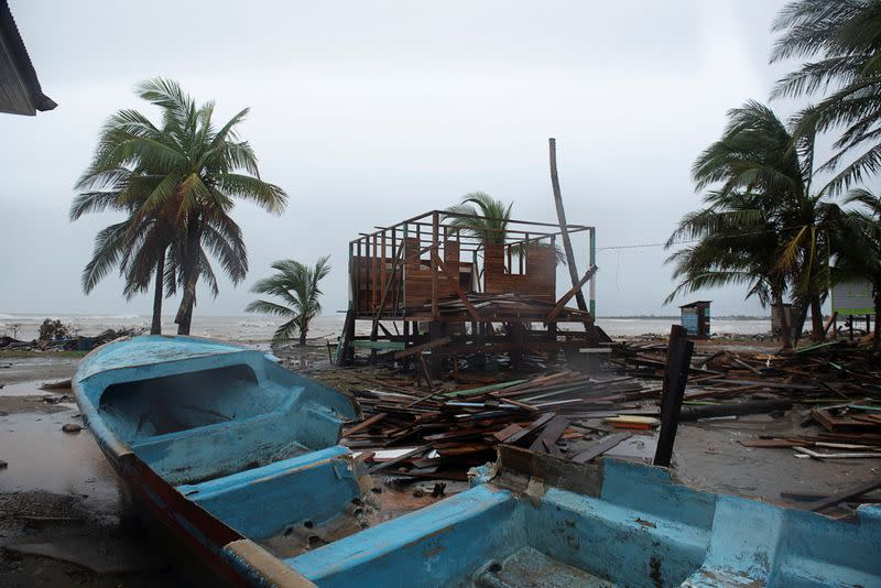 A damaged boat is seen on sand as Hurricane Iota approaches Puerto Cabezas
