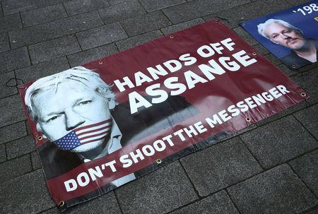 Banners in support of arrested WikiLeaks founder Julian Assange are seen on the pavement in front of Westminster Magistrates Court in London, Britain April 11, 2019. REUTERS/Hannah McKay