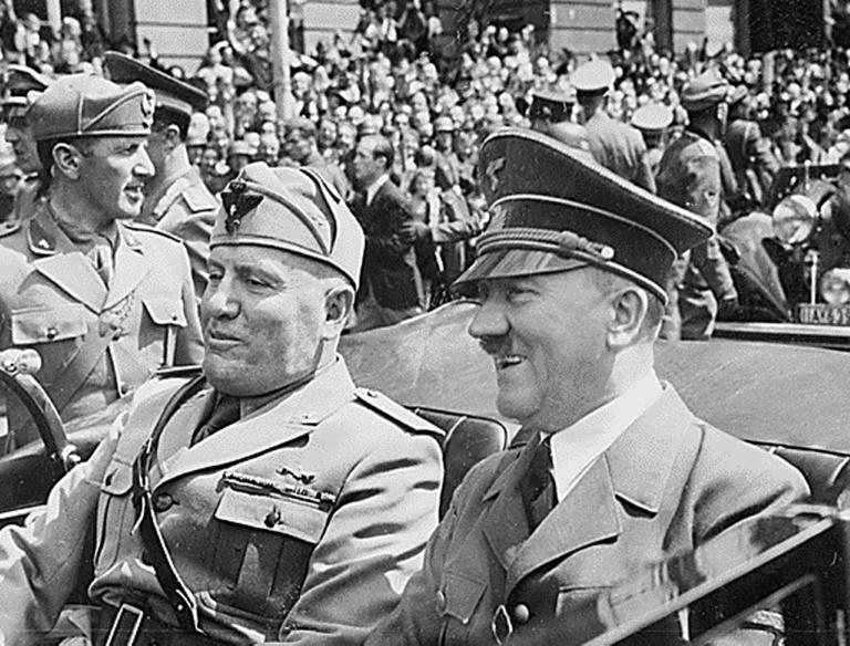 Japan engaged in a fierce lobbying campaign to win the 1940 Olympics including with Italy's fascist dictator Benito Mussolini (L) to step aside in their favour