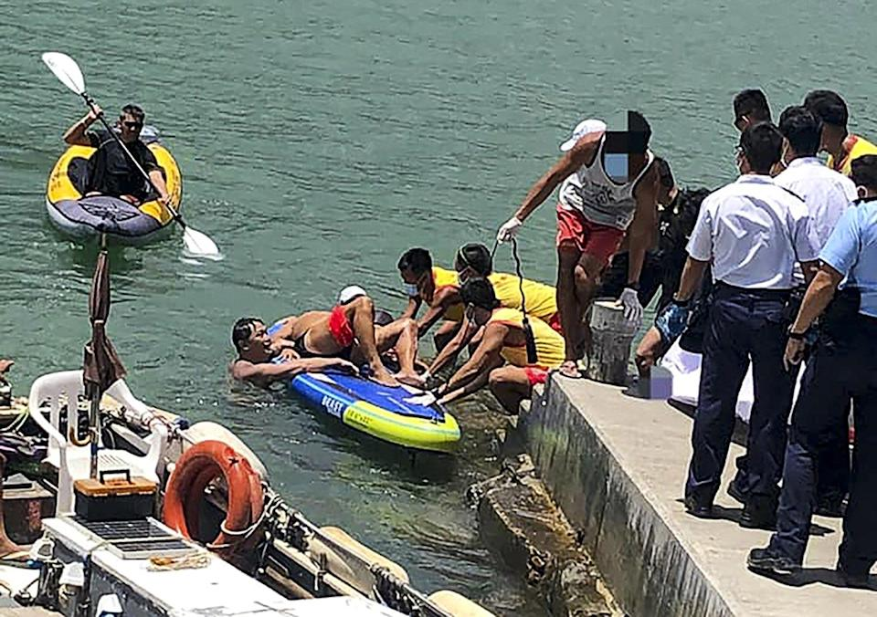 A swimmer is brought to shore after being hit by a speedboat propeller off Deep Water Bay Beach. Photo: Facebook